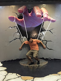 forced perspective of a puppet hand at Chiang Mai 3D Art Museum