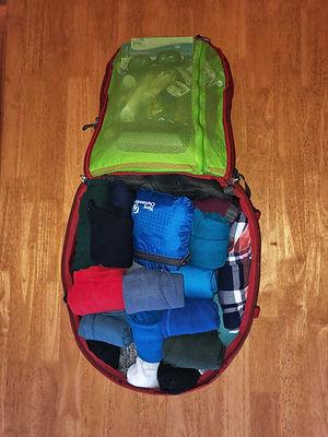 osprey backpack filled wih travel gear