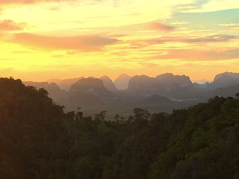 sunset from Tiger Cave Temple, Krabi, Thailand with limestone cliffs