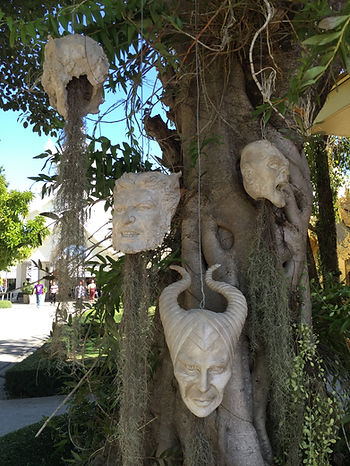Character heads of Maleficent, Wolverine and Gollum at Wat Rong Khun or the White Temple in Chiang Rai, Thailand