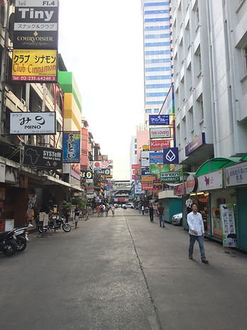 A walking street with shops and restaurants in Bangkok, Thailand