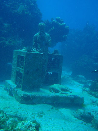 scuba diving at the MUSA underwater art museum on Isla Mujeres Mexico