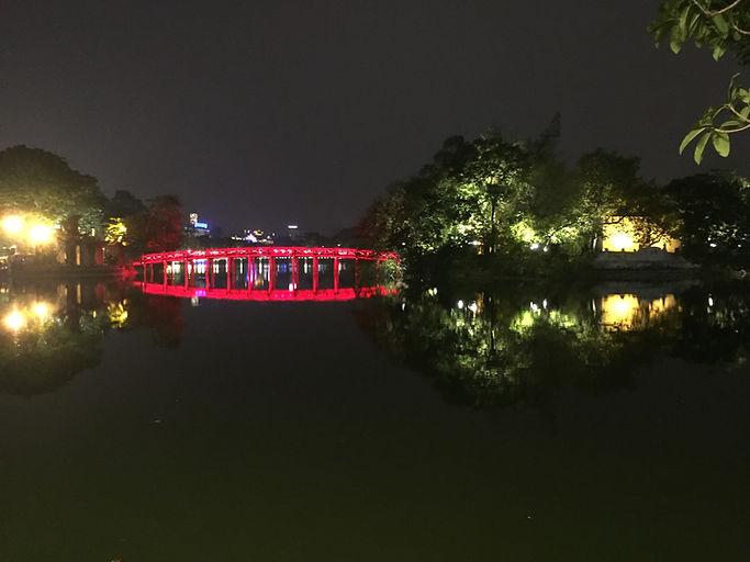 The brightly lt up bridge on Hoan Kiem Lake in Hanoi, Vietnam