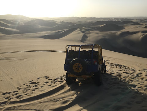 the ATV sandboarding tour through the dunes of the desert in Huacachina and Ica Peru
