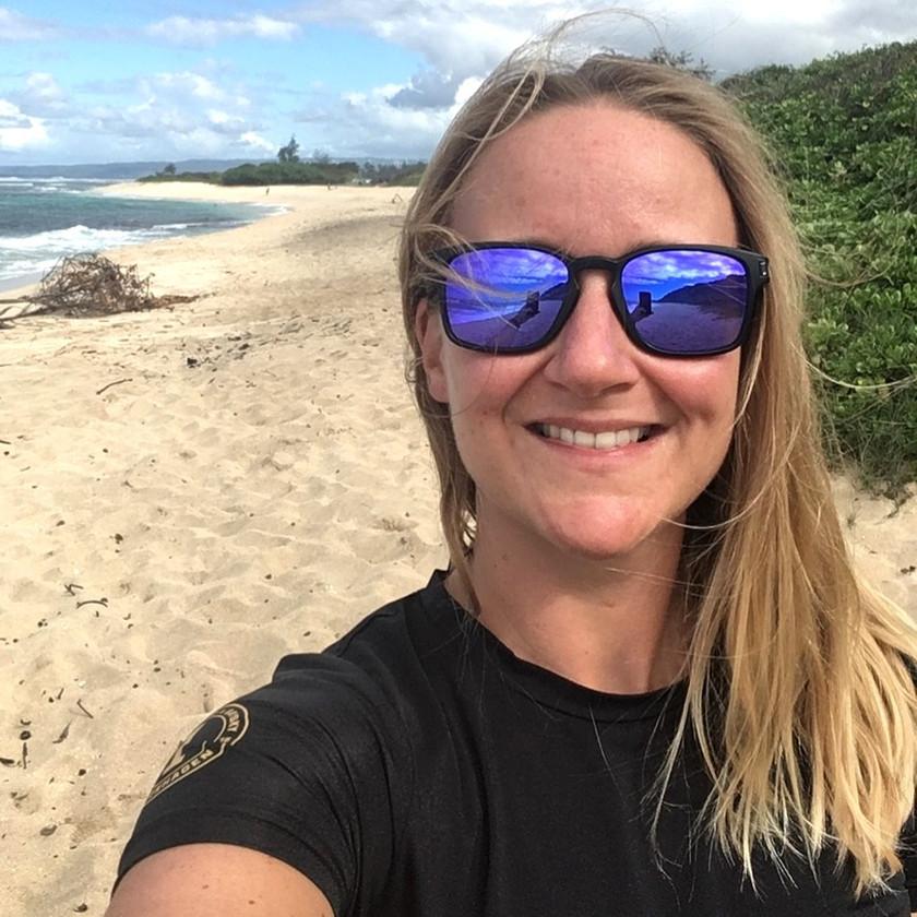 female solo traveler takes a selfie picture on a beach in ecuador