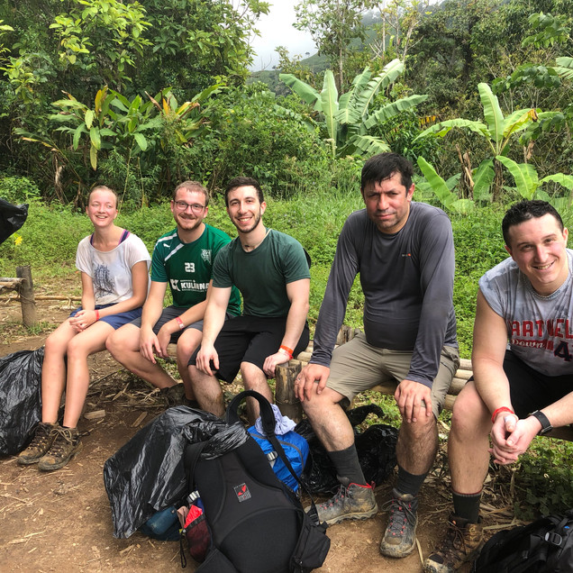 A group of tired hikers on the Lost City Trek in Colombia's Santa Marta Region