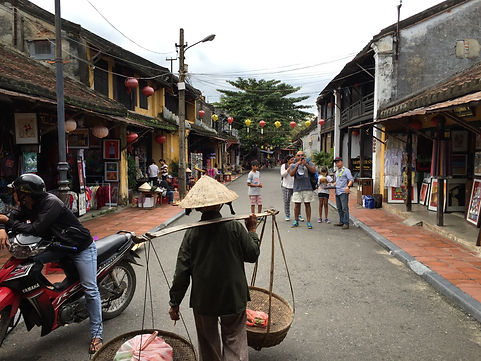 Following a local Vietnamese man in the Old Town of Hoi An Vietnam
