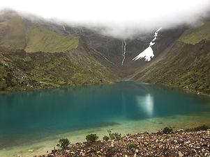 Humantay Lake on the Salkantay Trek with a glacier in the backgound near Cusco Peru