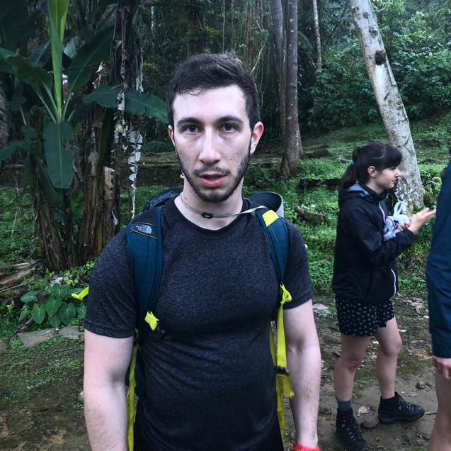 A tired American hiker in Colombia's Lost City Trek in the Santa Marta Region's jungle