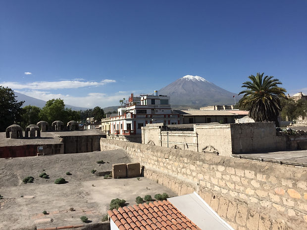 a rooftop view of Arequipa Peru with Volcan Misti in the distance
