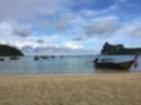 Railay Beach in Krabi, Ao Nang, Thailand with traditional Thai boats