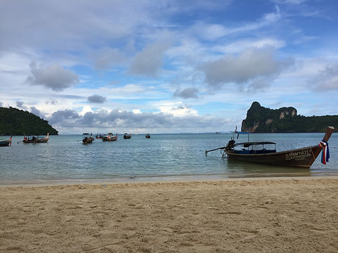 Railay Beach in Krabi, Ao Nang, Thailand with traditional Thai boats