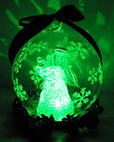 greencolour changing angel in glass globe christmas design
