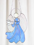 stained glass blue angel with dove bird