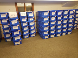 Schools library services blue boxes stacked up and awaiting delivery