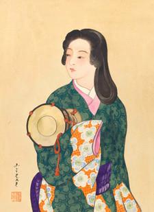 Junge Frau in Kimono mit Handtrommel