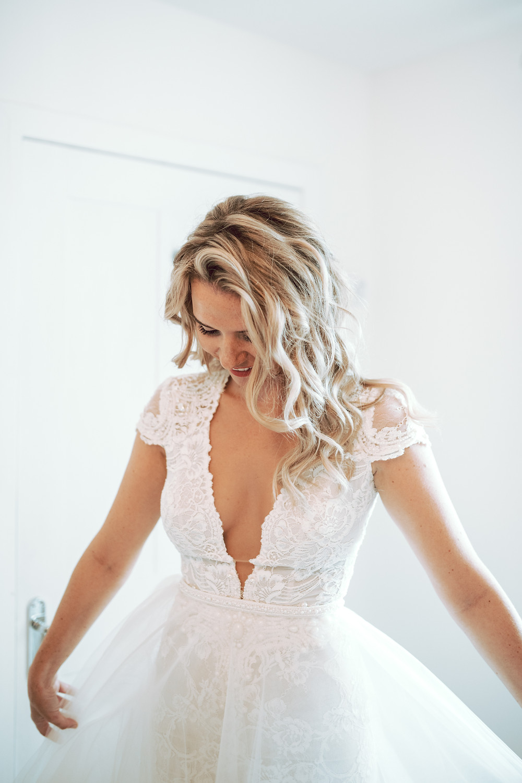 Bride wearing Berta dress and overskirt