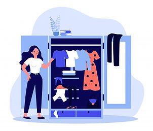 woman-standing-near-opened-closet-lookin