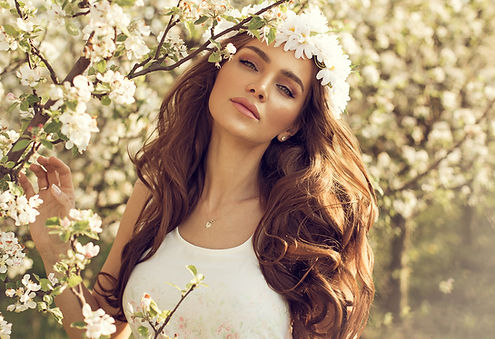 Beautiful natural woman in the garden of