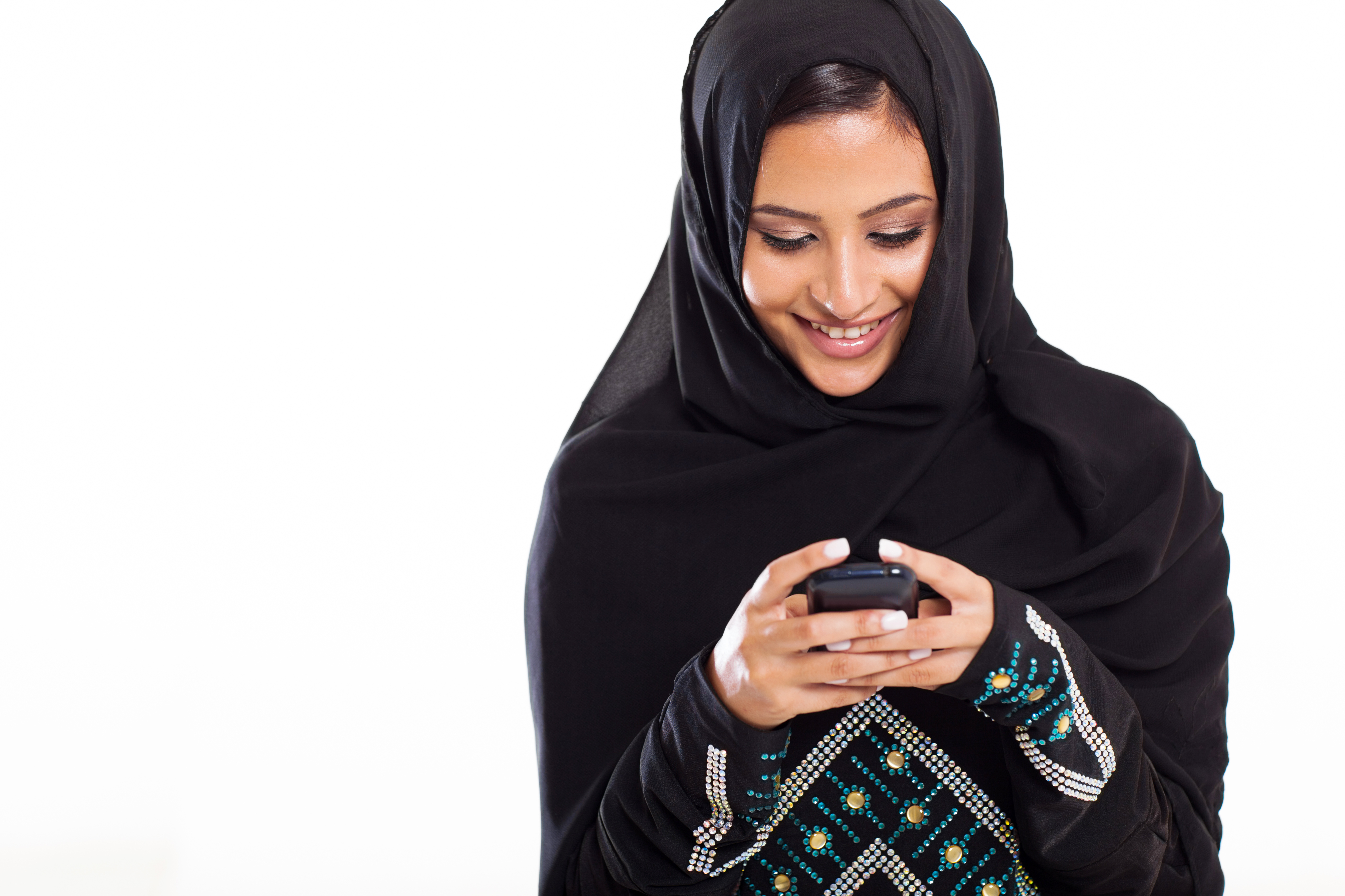 pretty modern Arabic woman playing on sm