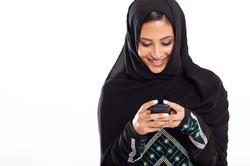 pretty modern Arabic woman playing on sm