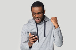 Excited african American millennial male