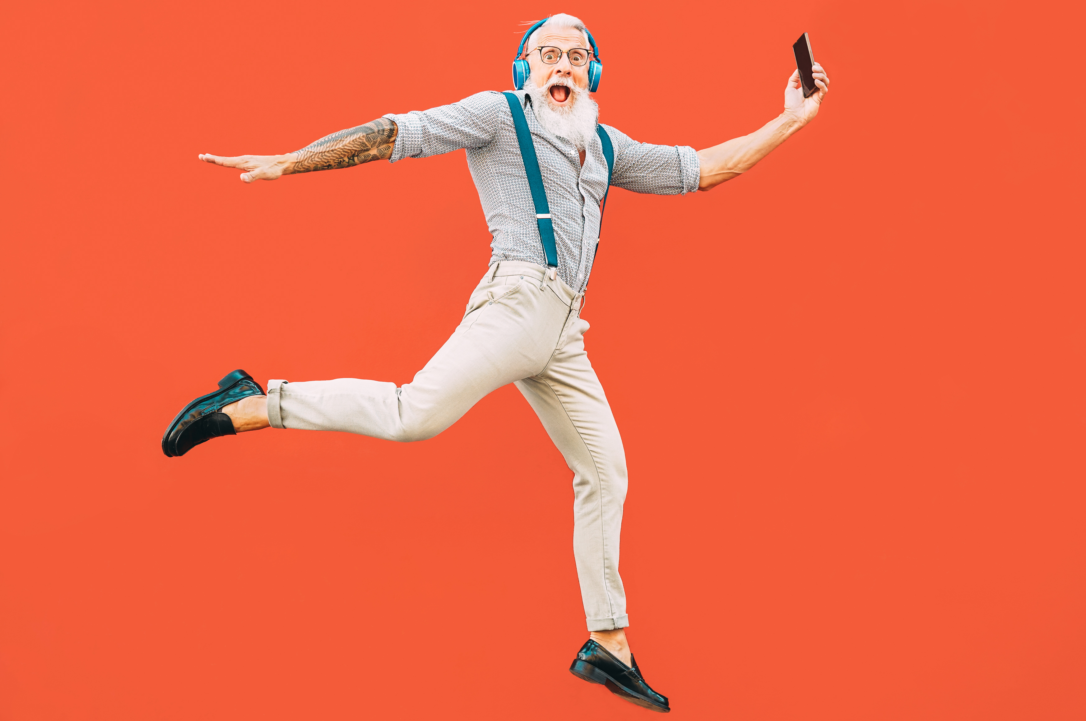 Senior crazy man jumping while listening