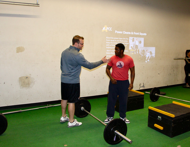 Coach Mike correcting form