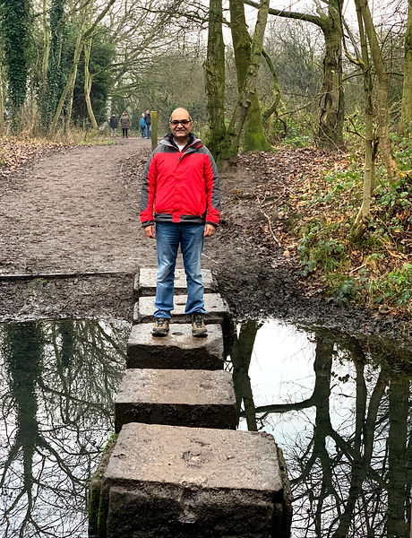 Amir standing on stones in the stream
