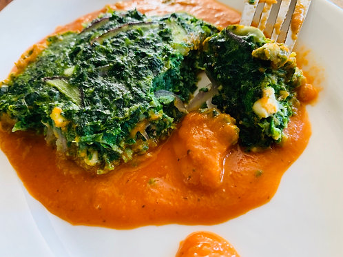 Spinach cake on sweet basil & tomato sauce