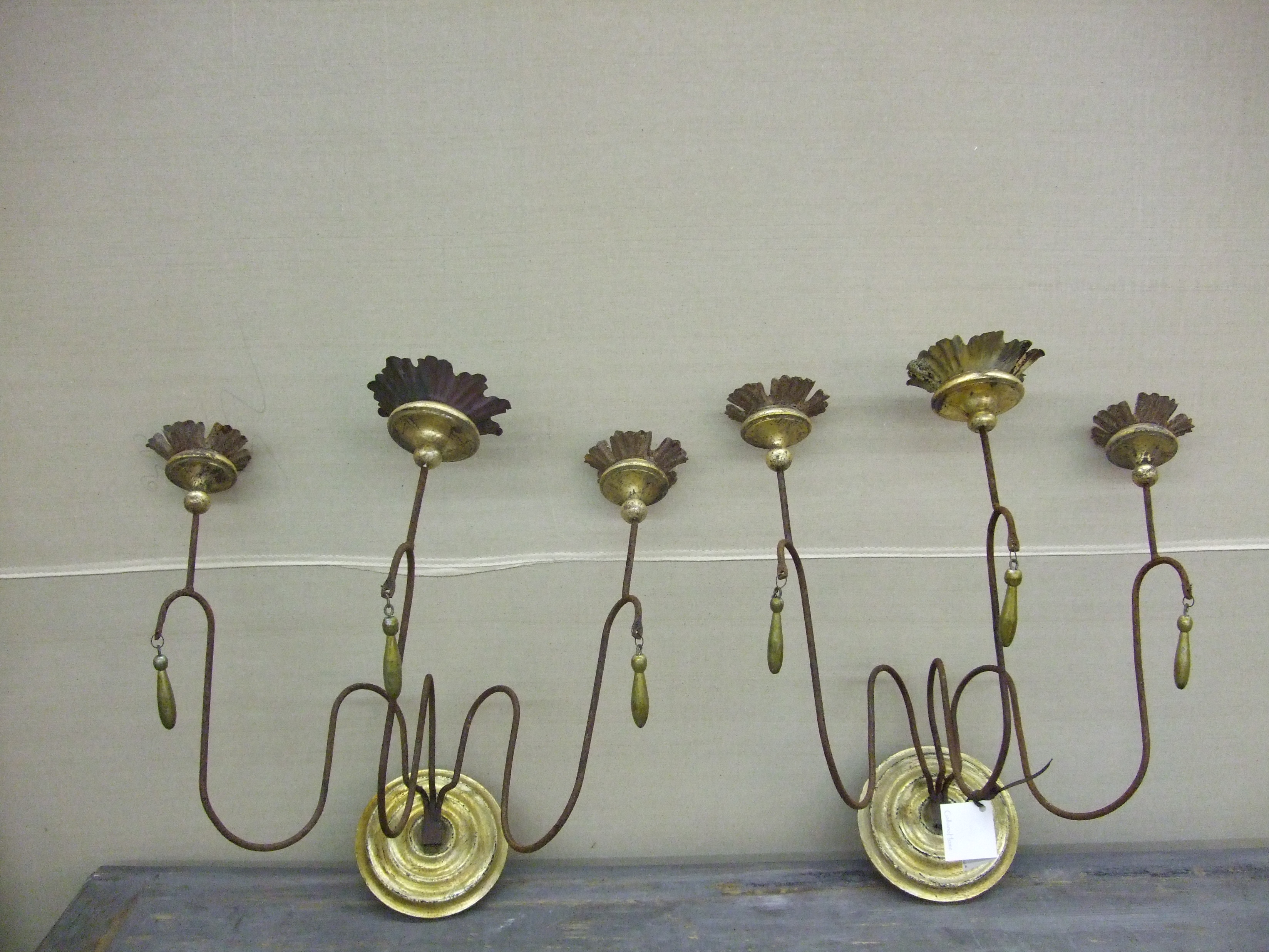 Iron and wood gilded sconces