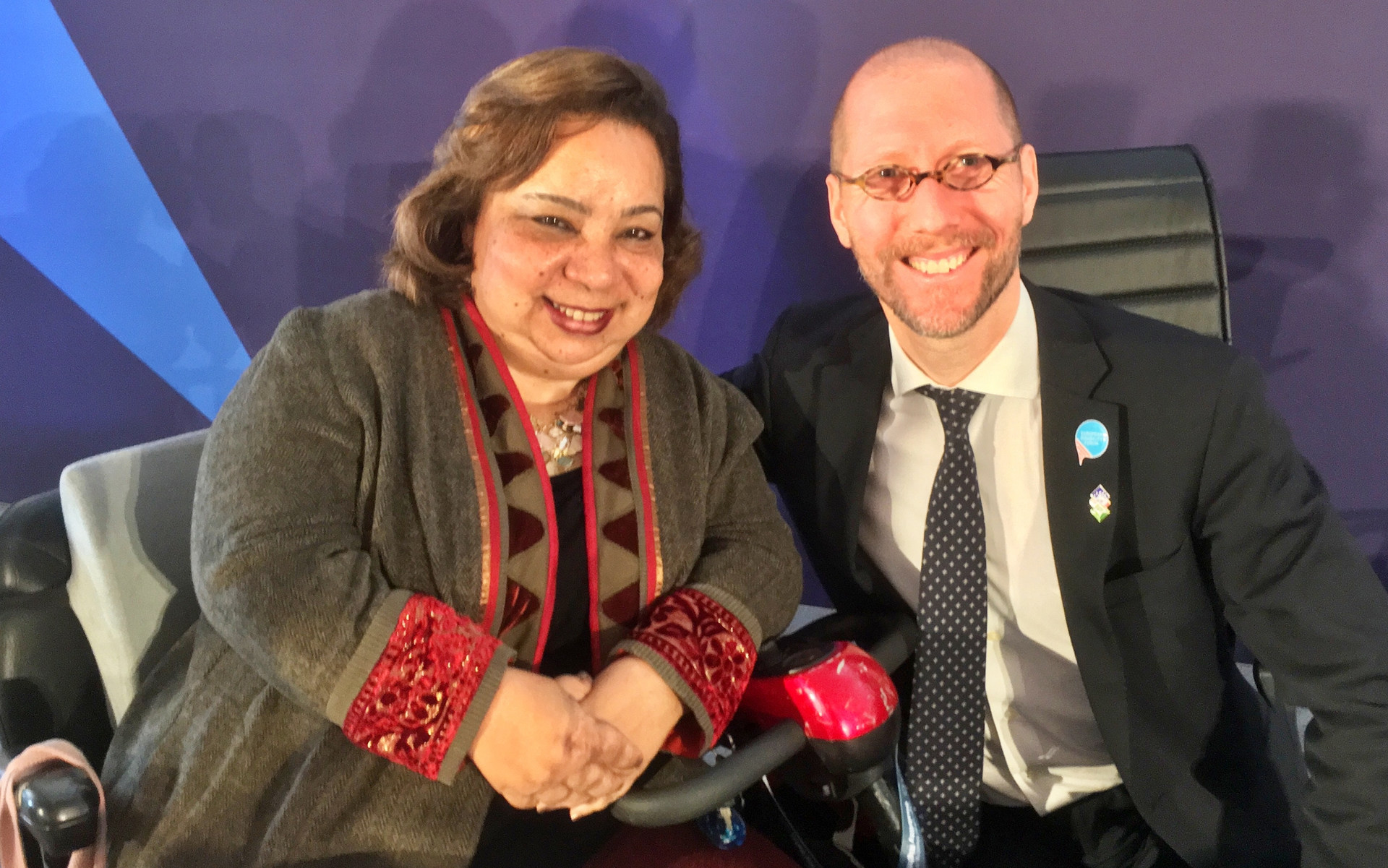 Discussing with Heba Hagrass, Member of Egyptian Parliament, about how to obtain a driver's license for deaf people in Egypt
