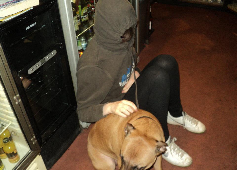 Hannah with a dog behind the bar