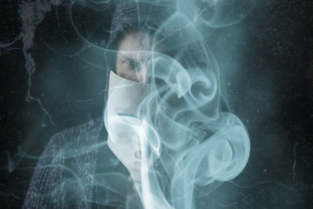 Man holding a mask with smoke Hannah Duncan Investment Content