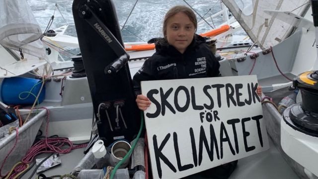 Greta Thunberg on a ship holding a skolstrejk sign Hannah Duncan Investment Content