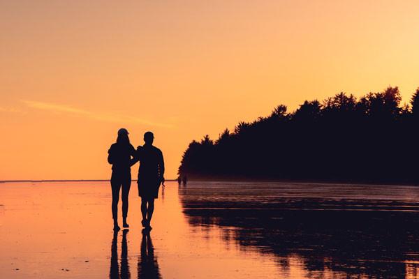 A couple walking on a beach