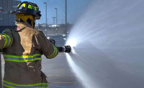 Firefighter with a firehose