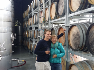 Couple embrace on wine tour in Marlborough NZ