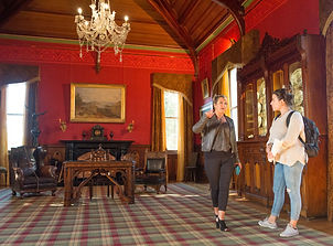 Guide and guest on tour of Larnach Castle in Dunedin