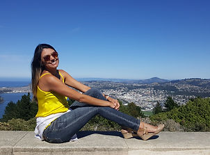woman sitting on wall at Signal Hill Lookout in Dunedin