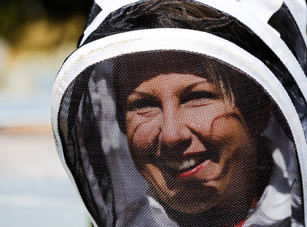 woman in bee suit on honey and hive tour in Dunedin