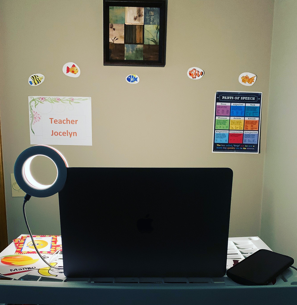 computer with ring light illuminating an online classroom.