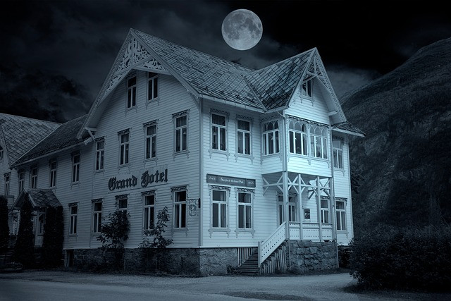Quaint looking hotel at night that gives a spooky feeling.