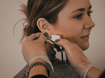 Ear piercing in action. hygienic, professional ear piercing at Serene Skincare