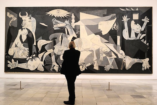 Person viewing Picasso's Guernica during a private visit to the Reina Sofia Museum in Madrid