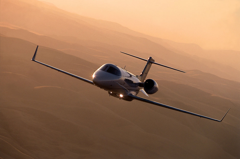 Gulftreem private jet flying in a sunset