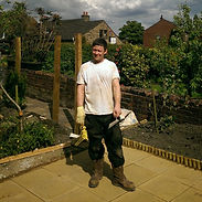 handyman stood in garden