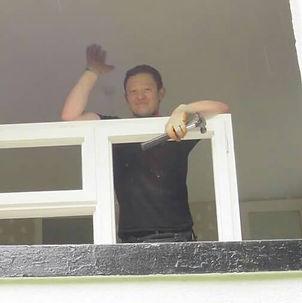 handyman waving