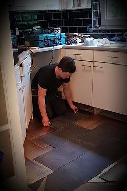 handyman laying tiles