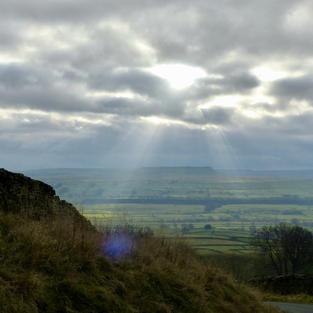 Shafts of sunlight over Swaledale
